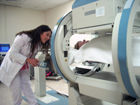 A member of the Griffin Hospital staff working with a patient in the Nuclear Medicine department with the Genesys.